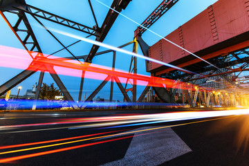 abstract image of blur motion of cars on the city road at night,Modern urban architecture in tianjing, China