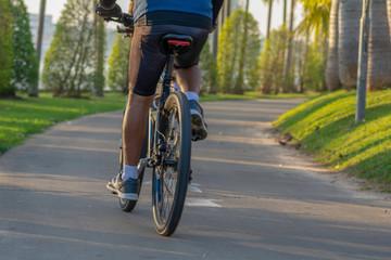 Biking in the park in the morning.