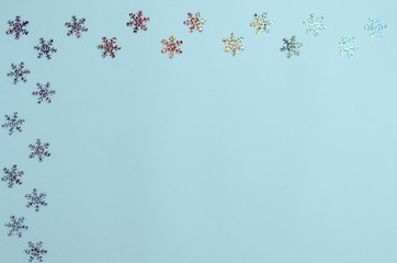 Many shimmering snowflakes on a blue background.