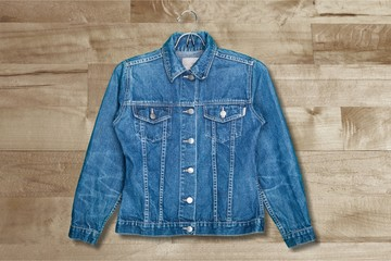 Denim jeans jacket on hanger isolated on white
