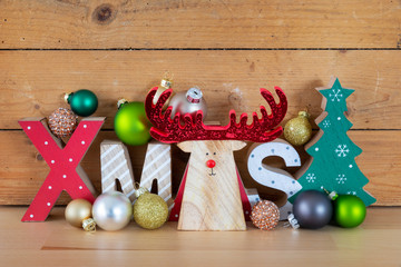 Christmas symbols decoration wooden reindeer with xmas text