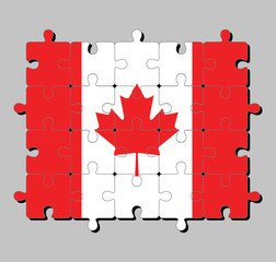 Jigsaw puzzle of Canada flag in a vertical triband of red and white with the red maple leaf. Concept of Fulfillment or perfection.