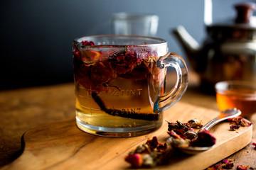 Vanilla tea with rose petals on cutting board