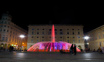 GENOA (GENOVA), ITALY, NOVEMBER 24, 2018 - View of the colorful fountain of De Ferrari Square by night in Genoa, the heart of the city, Italy.