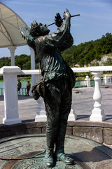 statue of a wandering musician on the street