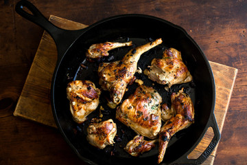 Overhead view of roasted rabbit†meat in frying pan