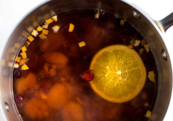 Close up of dried apricot, cherry and cranberry infusion in pan