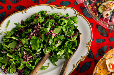 Close up of red and green salad served on a plat