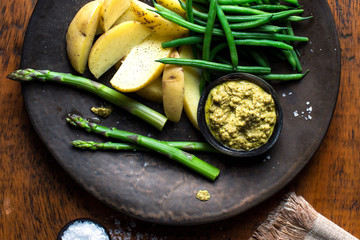 Close up of asparagus, green beans and potatoes with green mole sauce