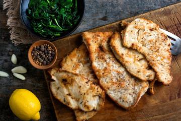 Close up of garlic chicken served on cutting board