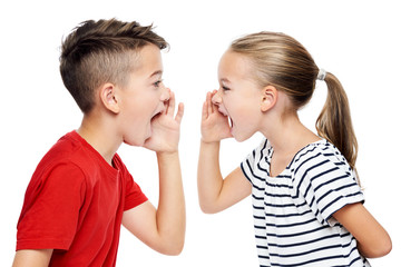 Young children facing eachother and shouting. Speech therapy concept over white background.