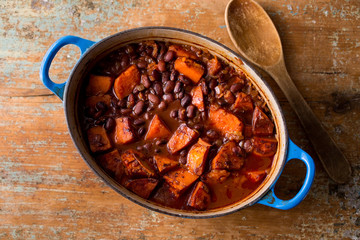 Overhead view of baked beans with sweet potatoes and chipotle