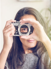 Woman holding camera without lens