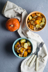 Salad of baked vegetables of pumpkins, potato, onion
