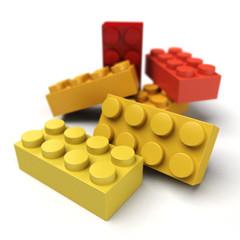 Plastic blocks red yellow close up