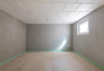Fototapeta Keller leerer Raum mit Betonwänden