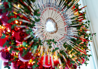 """A Christmas wreath made out of """"Be Best"""" pencils hangs in a window of the Red Room duirng Christmas Press Preview at White House in Washington"""