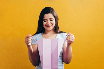Woman in shopping. Happy woman with shopping bags. Consumerism, shopping, lifestyle concept