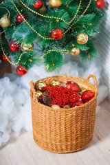 Wooden basket with toys in red under the Christmas tree