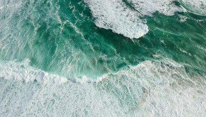 Aerial view of stormy ocean with waves. Drone photo