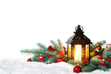 Christmas Lantern On Snow With Fir Branch isolated on white background - Winter Decoration Background