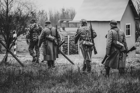 Four German soldiers in full gear