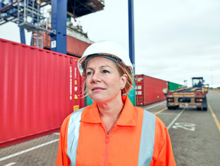 Dock manager portrait standing by containers at train side freight