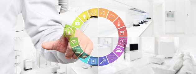 smart home automation control hand touch screen with colored symbols on indoors rooms background web banner and copy space template