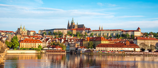 The beautiful landscape of the old town and the Hradcany (Prague Castle) with St. Vitus Cathedral and St. George church in Prague, Czech Republic. amazing places. popular tourist atraction