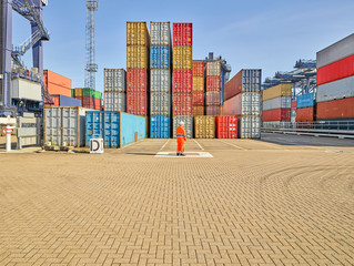 Survey of container stack by dock worker