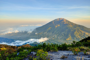 Fantastic view of Merbabu mountain at sunrise from Merapi volcano. Central Java, Indonesia