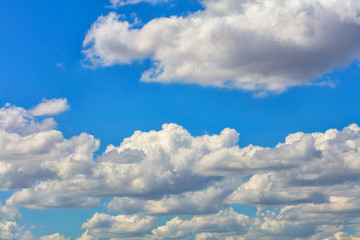 White clouds float in the blue sky