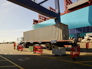Truck with cargo container at Port of Felixstowe, England