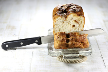Frisian Suikerbrood (sugarbread) with knife on glass plate