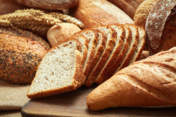 fresh baked bread on wooden background