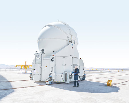 Scientist inspecting telescope at Paranal Observatory in Chile