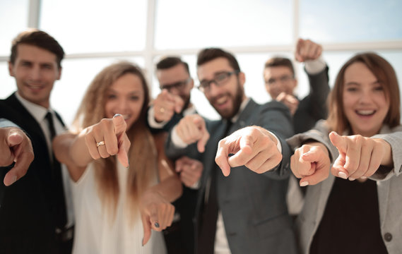 close up.a group of young business people pointing at you
