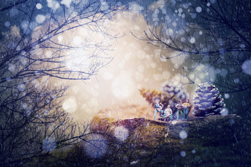 Group of friends( miniature) playing music,Fantastic winter landscape.Merry Christmas concept background.