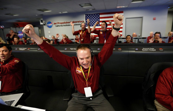 NASA engineer Kris Bruvold reacts in the space flight operation facility at NASA's Jet Propulsion Laboratory (JPL) as the spaceship InSight lands on the surface of Mars after a six-month journey, at JPL in Pasadena
