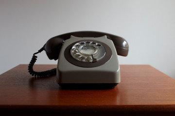 Antique telephone on wooden table