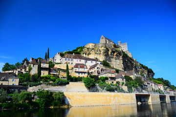 The medieval fortress and village of Beynac as seen from the Dordogne River in Aquitaine, France