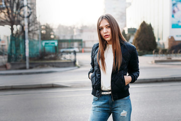 fashion model in black leather jacket posing outdoor