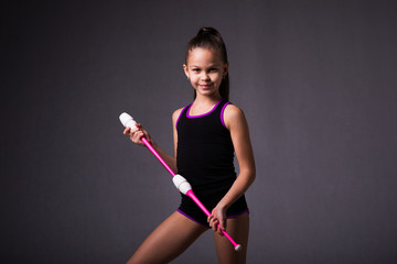 Photo sur Plexiglas Gymnastique Teenager girl holding in hand gymnastics clubs