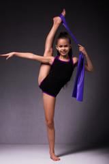 Foto auf Acrylglas Gymnastik Teenager girl involved in rhythmic gymnastics. Black background