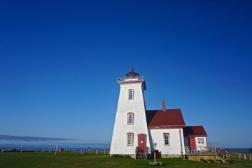 Prince Edward Island, Canada: Deep blue sky over the Wood Islands Lighthouse (1876), on the Northumberland Strait, a designated federal heritage building of Canada.