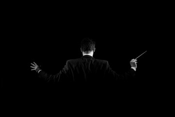 Rear view of conductor holding baton