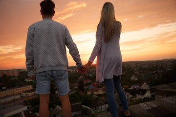 Couple in love at sunset.Couple holding hands