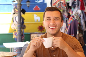 Ethnic man loving his cup of coffee