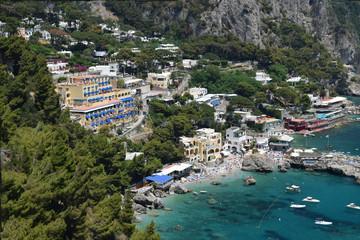 Panoramic view of the beach and hotels at Marina Piccola. Capri Island, Italy