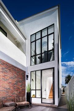 House exterior with open front door